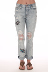 Front shows light blue denim crop relaxed straight ripped jeans with monarch butterflies. Shown worn with sandals.