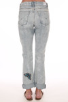 Back shows Light blue denim crop relaxed straight jeans with monarch butterfly on let ankle. Shown worn with sandals.
