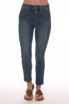 Front shows dark blue denim ankle jeans. Shown with sandals.