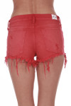 Back shows bright red distressed cut off shorts with pockets.
