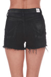 Back shows black slightly distressed high rise button fly shorts with pockets.