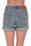 Back shows cuffed long 501 denim shorts with rip on left side and pockets and tag at top on waist.