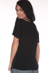 Back shows plain black distressed tee.