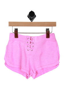 Front shows pink lace up shorts.