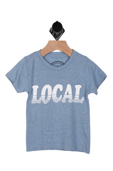 "Front: Light blue tee with ""LOCAL"" printed on front in white."