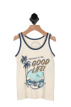 """Front shows summer tank with """"Welcome To The Good Life"""" words and printed palm trees next to ocean scene."""