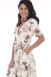 Side shows ivory and floral waste wrap dress with V-shape top.