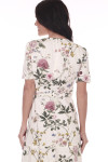 Back shows ivory and floral waste wrap dress with V-shape top.