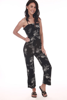 Front: White floral patterned black ankle length jumper suit with spaghetti straps and small v-shape top.
