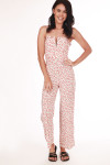 Front shows white and cherry patterned ankle length jumper suit with spaghetti straps. and small v-shape top. Shown wearing black with sandals.