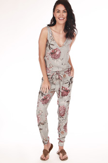 Front: Pink floral pattern and grey base color tank jumpsuit with v-neck and waste tie.