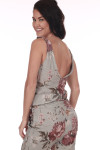 Back shows grey tank jumpsuit with large pink floral pattern and low v-shape back.