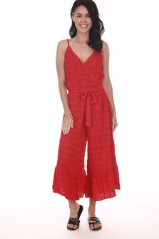 Front: Red wide leg cropped jumpsuit with spaghetti straps, v-shape neckline, and waste tie.