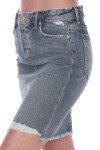 Front side shows distressed light blue denim jean skirt with pockets. Mid thigh length.