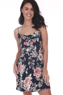 Front shows black and large rose patterned mini dress with square neckline with adjustable straps.