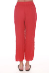 Back  shows red gauze pants with raw hem. Pants fit to ankles.