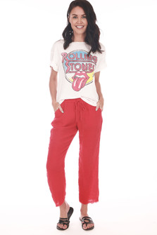 Front shows red gauze pants with raw hem and string waste tie. Pants fit to ankles.