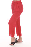 Side shows red gauze pants with pockets raw hem, and string waste tie. Pants fit to ankles.