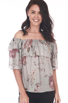 Front shows off the shoulder floral blouse with mid sleeves and one layer ruffle at top. Grey base color with light pink floral.