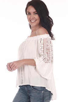 Side: Ivory off-shoulder 3/4 sleeve classy blouse with lace crochet designs down the arms and down middle front.