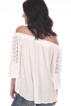 Back shows ivory off-shoulder classy blouse with lace crochet designs down the arms and plain ivory color at back.