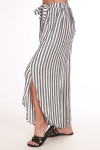 Side shows long grey and white striped flow pants with slit on the side legs and long outer skirt with waste tie wrap.