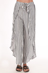 Front shows long grey and white striped flow pants with connected waste tie. Slits on the side legs.