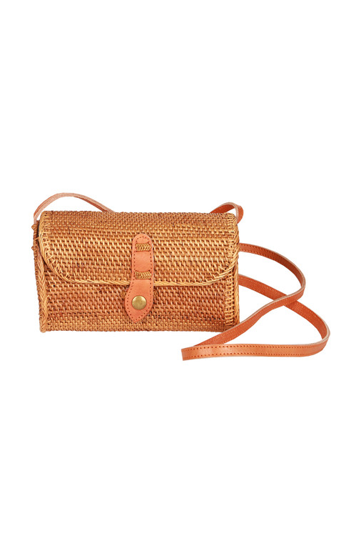 Long small tan rattan cross-body clutch purse. Comes with long strap and one button on the front.