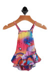 Front shows Bright and colorful outer space one-piece spaghetti strap bathing suit. Designed with unicorns, rainbows, and peace signs with ruffled bottom half.