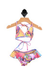 Front shows colorful and bright two-piece bikini bathing suit. Designed with unicorns and rainbows with ruffled bottom suit.