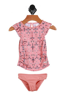 Front shows cute two-piece pink and star tribal designed bathing suit. Top suit covers the stomach.