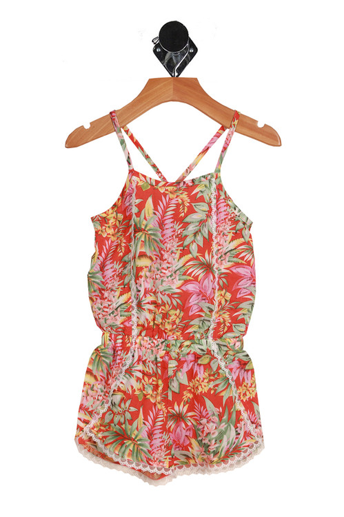 Front shows green, pink, and yellow Hawaiian designed shorts romper. Spaghetti straps and front and criss-cross straps at back.