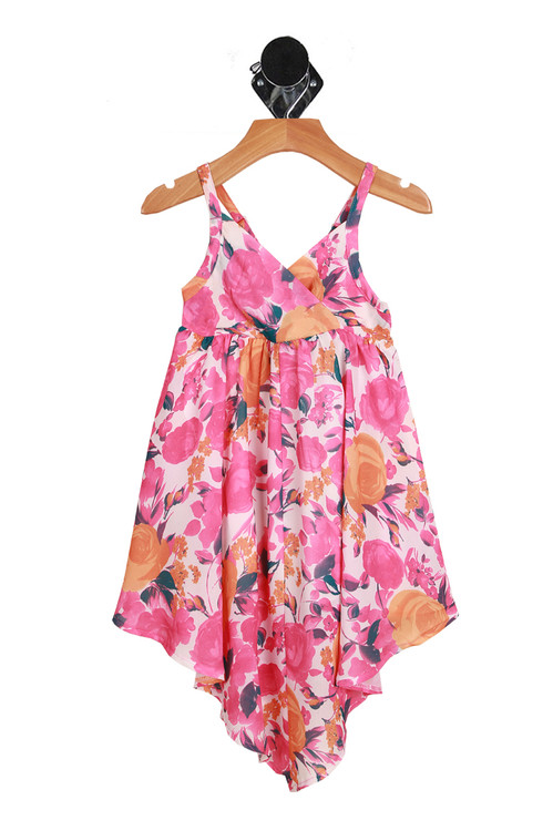 Front: Pink spaghetti strap floral summer dress with v neck and v shape bottom of dress.