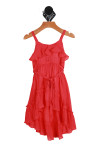 Front shows coral colored short dress with spaghetti straps with ruffle flap detail at top, elastic band at waist, matching braided belt and high lo bottom hemline.
