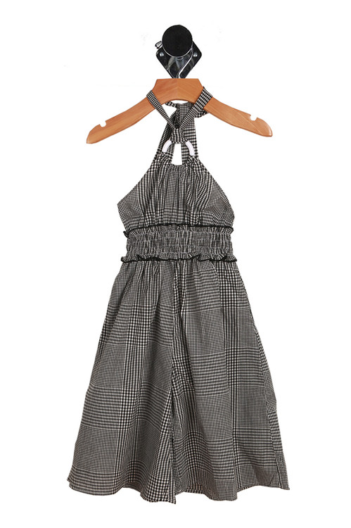 Front shows criss-cross summer halter dress with round connecting piece in the middle of chest. Black and white checker design.