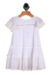 Front: Elegant summer dress with lacy hemline sleeves. Dress is tiered.