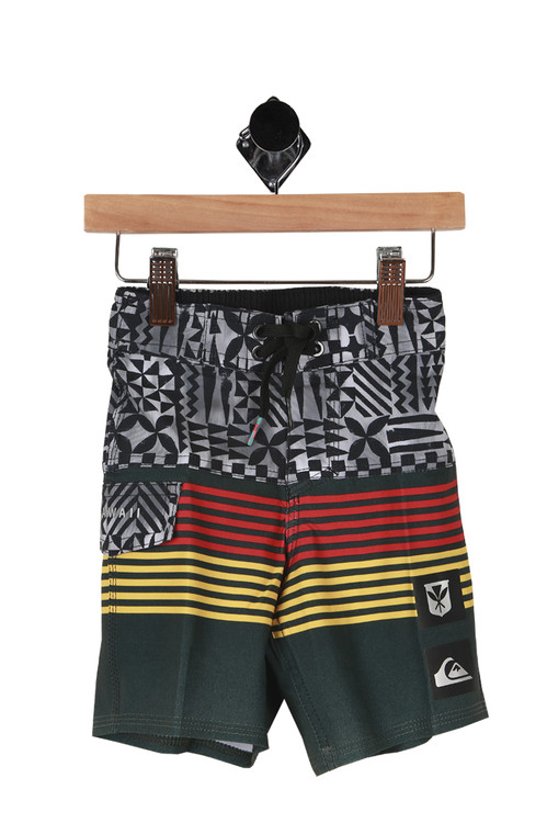 Front shows multi colored swim trunks. Top half black and white tribal designs and bottom half green with yellow and red stripes.
