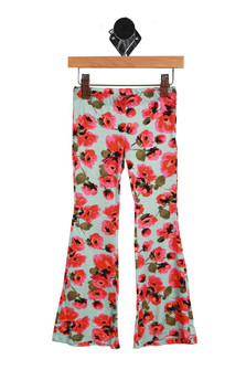 Front shows flare pants with pink, orange, green floral print and light blue background.