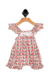 front features white, black and ivory print all over, ruffle sleeves, and crochet top hemline. Ruffle hemline at bottom.