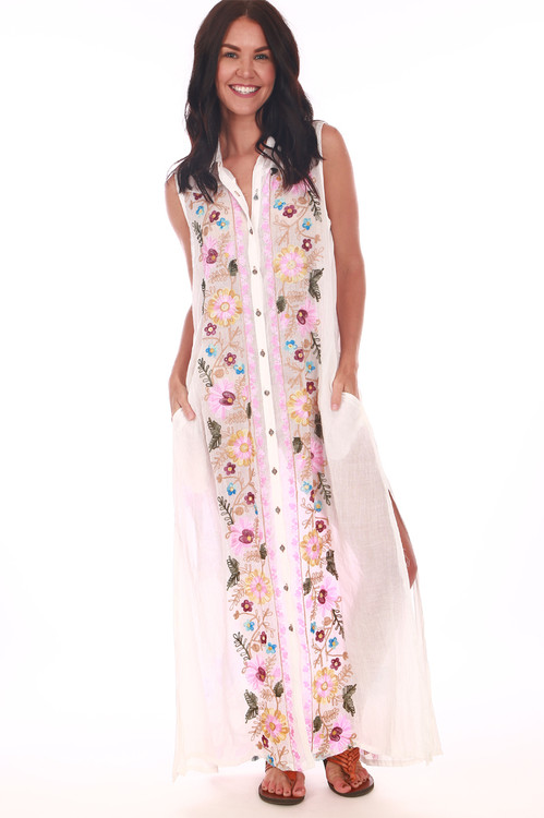 full body front shows button down with tank sleeves, collar & embroidered flowers down center. Model has hands in side pockets.
