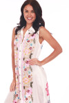front shows button down with tank sleeves, collar & embroidered flowers down center.