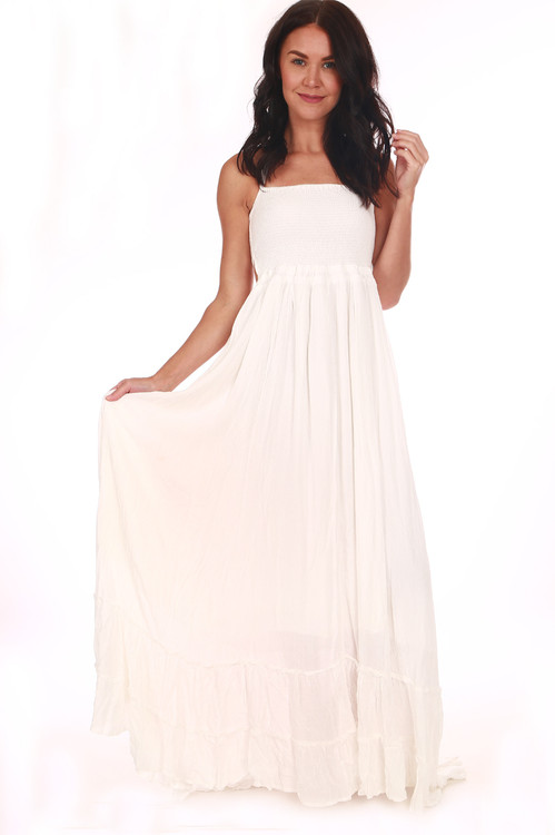 Front shows All white long  spaghetti strap flowing maxi dress.