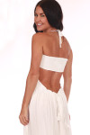 Back shows All white long maxi dress with spaghetti strap halter straps that tie at neck and open low rise back with adjustable tie.