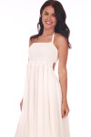 Front shows all white long flowing maxi dress with spaghetti strap halter straps.