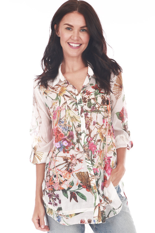Front shows long sleeve embroidered multi floral patterned applique button down shirt.