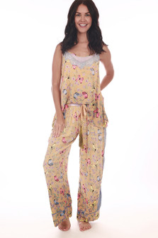 Front shows golden floral and butterfly  designed pajama pants with front tassel tie.