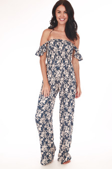 full front shows off the shoulder ruffle sleeves with smocked upper half and wider straight leg pants that go all the way to floor. Print is in dark teal & cream flowers.
