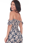 close back shows off the shoulder ruffle sleeves with smocked upper half and print is in dark teal & cream flowers.