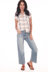 full body image shows plaid button up short sleeve shirt paired with denim ankle cut jeans.