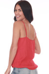 Back shows bright red adjustable spaghetti strap blouse made with satin material. Shown paired with light blue jeans.